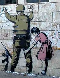 Banksy girl searching soldier