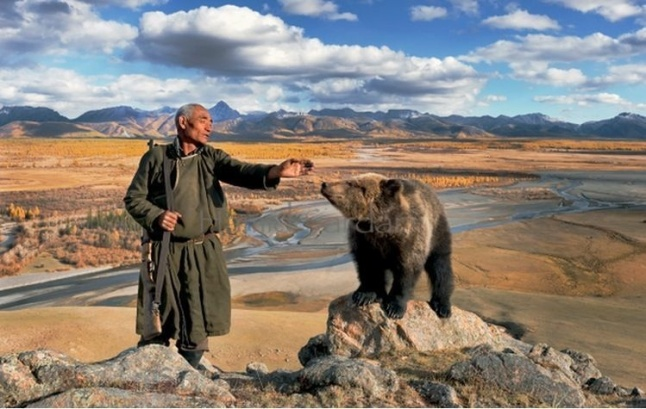 Mongolian man with bear and mountains